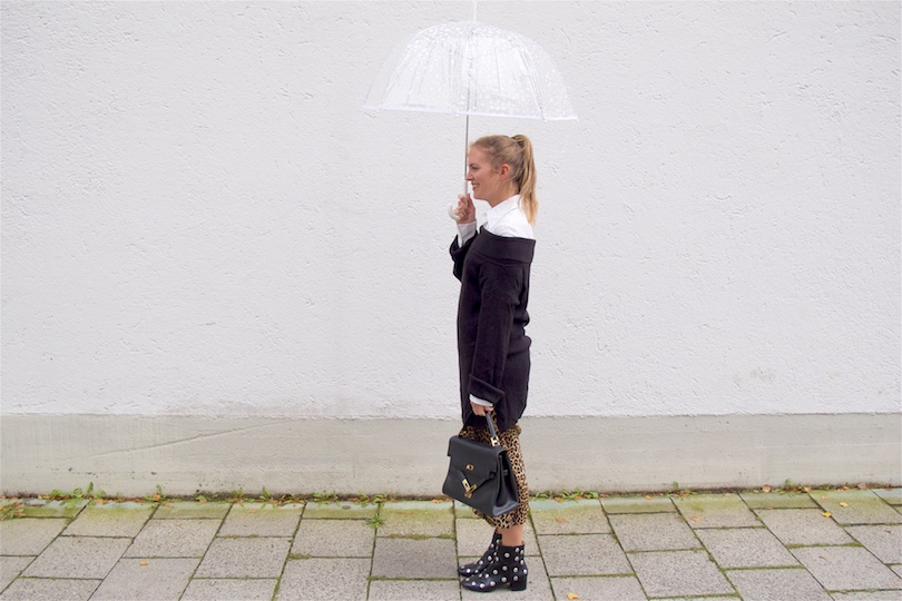 Leopard Culottes. Fashion Blogger Girl by Style Blog Heartfelt Hunt. Girl with blond ponytail wearing leopard culottes, blouse, off shoulder sweater, vintage MCM bag, umbrella and studded boots.