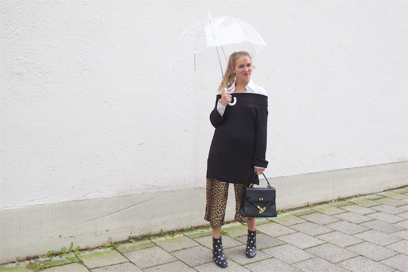 Leopard Culottes. Fashion and Style Blog Girl from Heartfelt Hunt. Girl with blonde ponytail wearing leopard culottes, blouse, off shoulder sweater, vintage MCM bag, umbrella and studded boots.