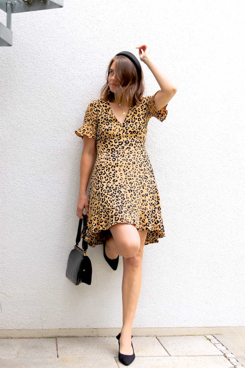 Leopard Dress. Fashion and Style Blog Girl from Heartfelt Hunt. Girl with blonde long bob and padded headband wearing a leopard dress, vintage purse and pointed toe heels.