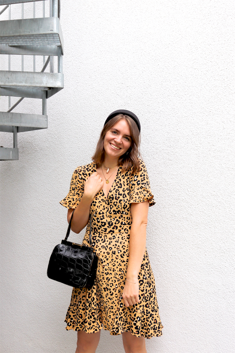 Leopard Dress. Fashion Blogger Girl by Style Blog Heartfelt Hunt. Girl with blond long bob and padded headband wearing a leopard dress, vintage purse and pointed toe heels.