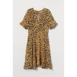 Leopard Dress. Fashion and Style Blog Girl from Heartfelt Hunt showing a look with a leopard dress.
