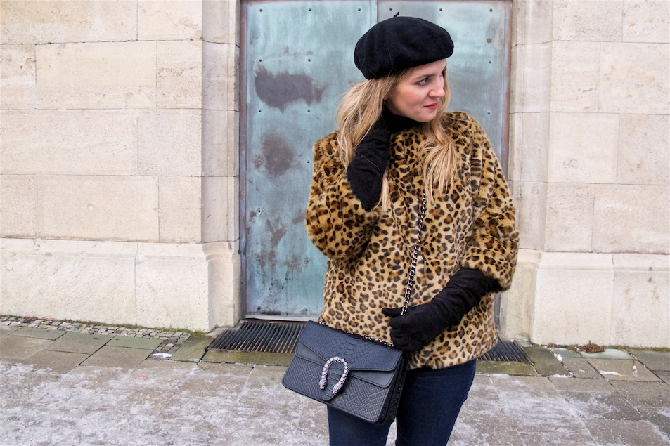 Leopard Jacket. Fashion and Style Blog Girl from Heartfelt Hunt. Girl with blonde loose curls wearing a faux fur leopard jacket, turtleneck sweater, jeans, beret, bag and boots.