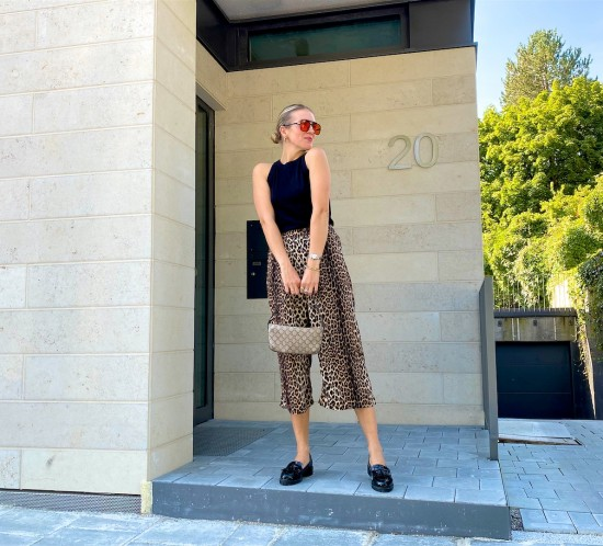 Leopard Pants. Fashion Blogger Girl by Style Blog Heartfelt Hunt. Girl with blond sleek low bun wearing leopard pants, black top with bow, orange sunglasses, vintage Gucci bag and loafers.