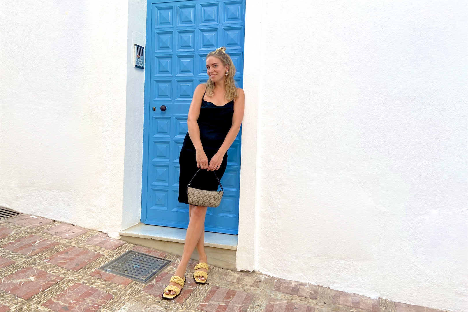 Little Black Dress. Fashion Blogger Girl by Style Blog Heartfelt Hunt. Girl with blond half-up half-down hairstyle and scrunchie wearing a little black dress, Gucci bag and braided sandals.