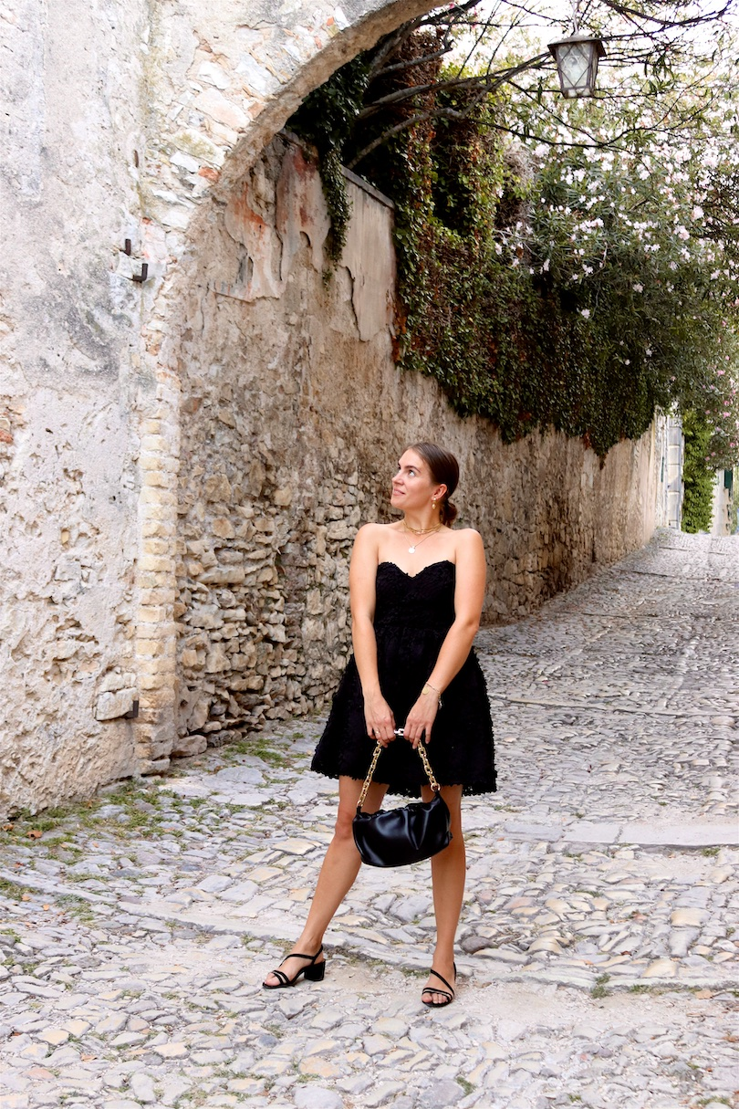 Little Black Dress. Fashion Blogger Girl by Style Blog Heartfelt Hunt. Girl with blond, low bun wearing a little black dress, pouch bag and strappy heels.