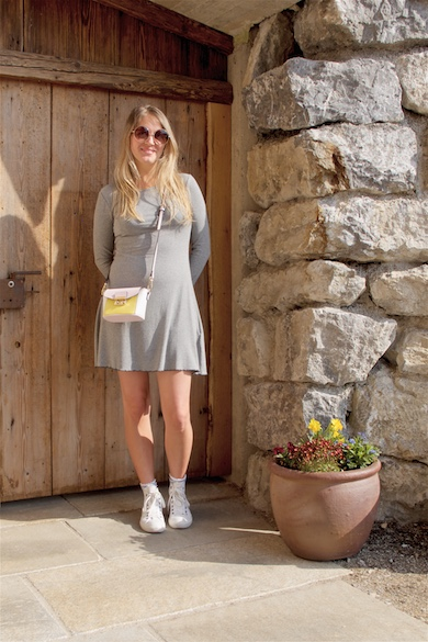 Little Gray Dress. Fashion Blogger Girl by Style Blog Heartfelt Hunt. Girl with blond hair wearing a little gray dress, round sunglasses, color block bag and Converse sneakers.