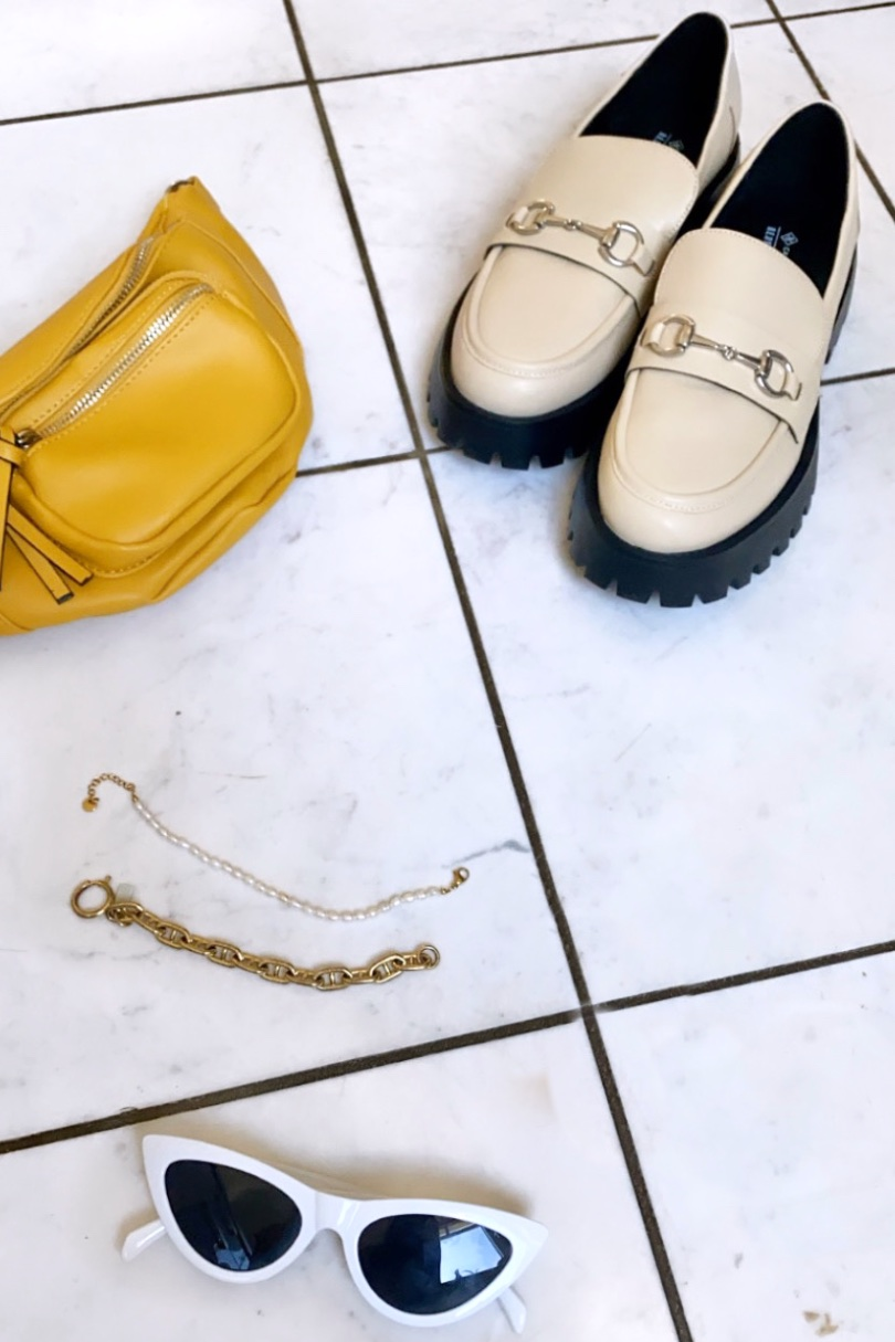Loafers Trend. Fashion and Style Blog Girl from Heartfelt Hunt. Girl with blonde half-up half-down hairstyle wearing check pants, check blazer, yellow tee, yellow belt bag and chunky loafers.