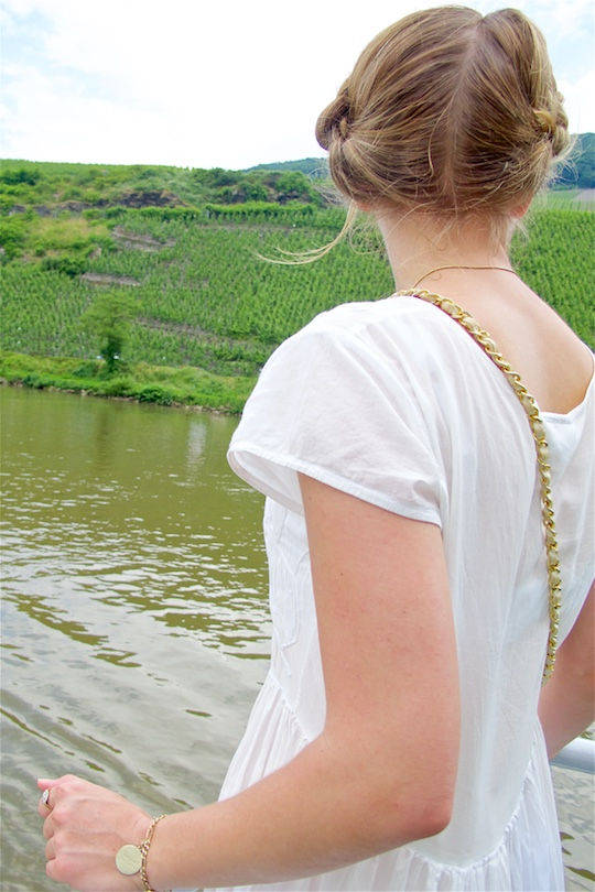 Moselle Cruise. Fashion Blogger Girl by Style Blog Heartfelt Hunt. Girl with milkmaid braid wearing a white maxi dress, Chanel bag and sandals.