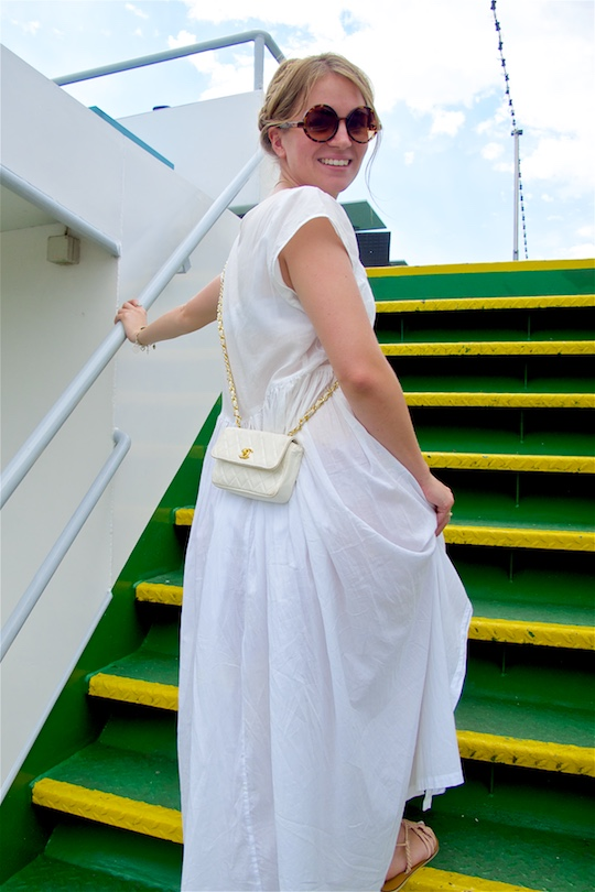 Moselle Cruise. Fashion and Style Blog Girl from Heartfelt Hunt. Girl with milkmaid braid wearing a white maxi dress, Chanel bag, sunglasses and sandals.