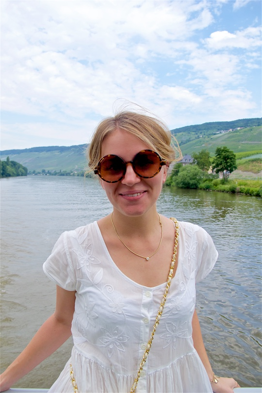 Moselle Cruise. Fashion Blogger Girl by Style Blog Heartfelt Hunt. Girl with milkmaid braid wearing a white maxi dress, Chanel bag, sunglasses and sandals.