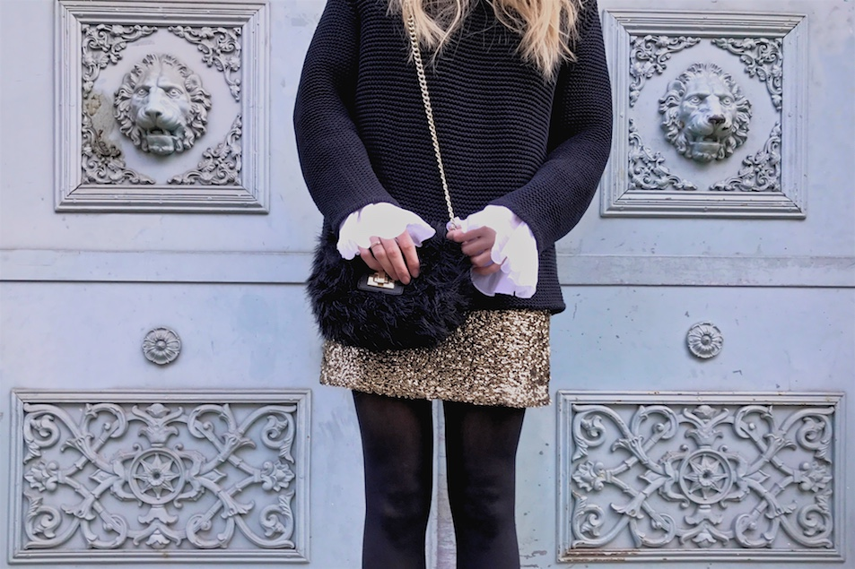 New Year's Eve 2016. Fashion and Style Blog Girl from Heartfelt Hunt. Girl with blonde loose curls wearing a heavy knit sweater, blouse with trumpet sleeves, golden sequin dress, pompom beanie, faux fur bag and boots.