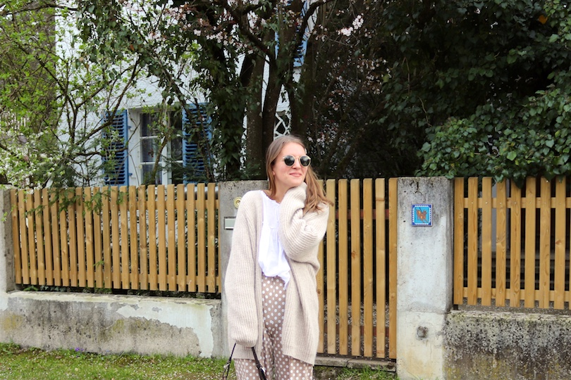 Nude Polka Dots. Fashion Blogger Girl by Style Blog Heartfelt Hunt. Girl with blond hair and pearl hair clips wearing nude pants with polka dots, chunky cardigan, white blouse, pearl hair clips, Ray-Ban sunglasses, brown vintage Prada purse, brown Tod's boots.