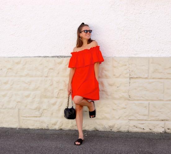 Orange Summer Dress. Fashion Blogger Girl by Style Blog Heartfelt Hunt. Girl with blond half-up half-down hairstyle bun wearing an orange summer dress, slim cat-eye sunglasses, pouch bag and sandals.