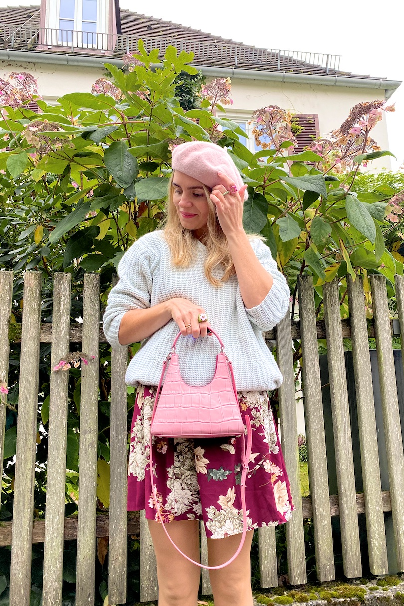 Pastel For Fall. Fashion Blogger Girl by Style Blog Heartfelt Hunt. Girl with blond hair wearing a mint pastel sweater, pastel pink beret, floral dress, pink Staud bag and off-white loafers.