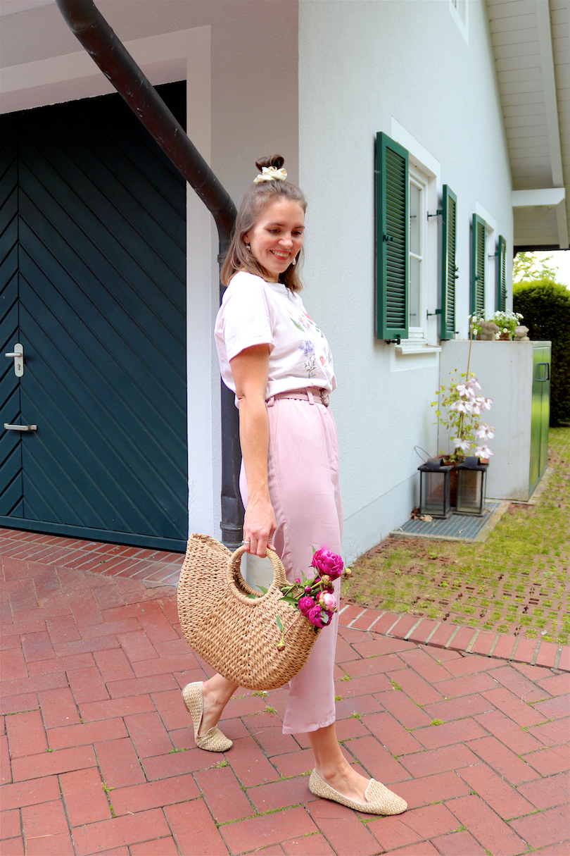 Peony Season. Fashion and Style Blog Girl from Heartfelt Hunt. Girl with blonde half-up half-down hairstyle and scrunchie wearing a graphic tee, paperbag culottes, eye earrings, straw bag and straw flats. Summer Looks and Styles.