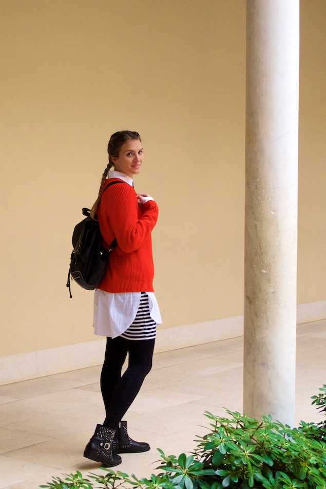 Picasso Museum. Fashion Blogger Girl by Style Blog Heartfelt Hunt. Girl with blond double dutch braids wearing a red sweater, long blouse, striped skirt, backpack and studded boots.