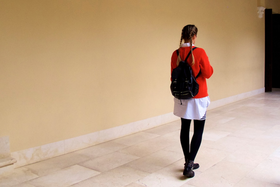Picasso Museum. Fashion and Style Blog Girl from Heartfelt Hunt. Girl with blonde double dutch braids wearing a red sweater, long blouse, striped skirt, backpack and studded boots.