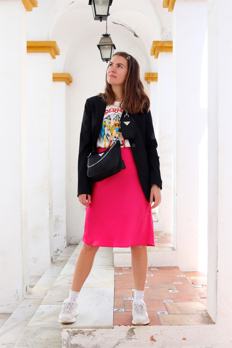 Pink Skirt. Fashion and Style Blog Girl from Heartfelt Hunt. Girl with blonde hair wearing a blazer, graphic tee, statement necklace, pink skirt, bag and chunky sneakers.
