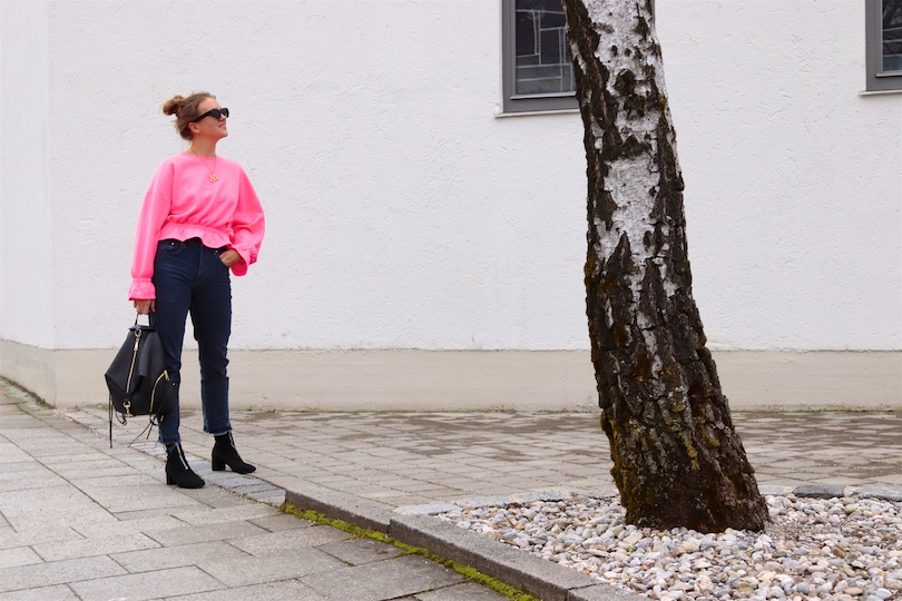 Pink Sweater. Fashion Blogger Girl by Style Blog Heartfelt Hunt. Girl with blond, high, messy bun wearing a pink sweater, mom jeans, slim sunglasses, Rebecca Minkoff backpack and sock boots.