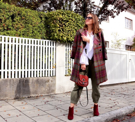 Plaid Coat. Fashion Blogger Girl by Style Blog Heartfelt Hunt. Girl with blond hair wearing a plaid coat, white blouse, cargo pants, Michael Kors bag and burgundy booties.