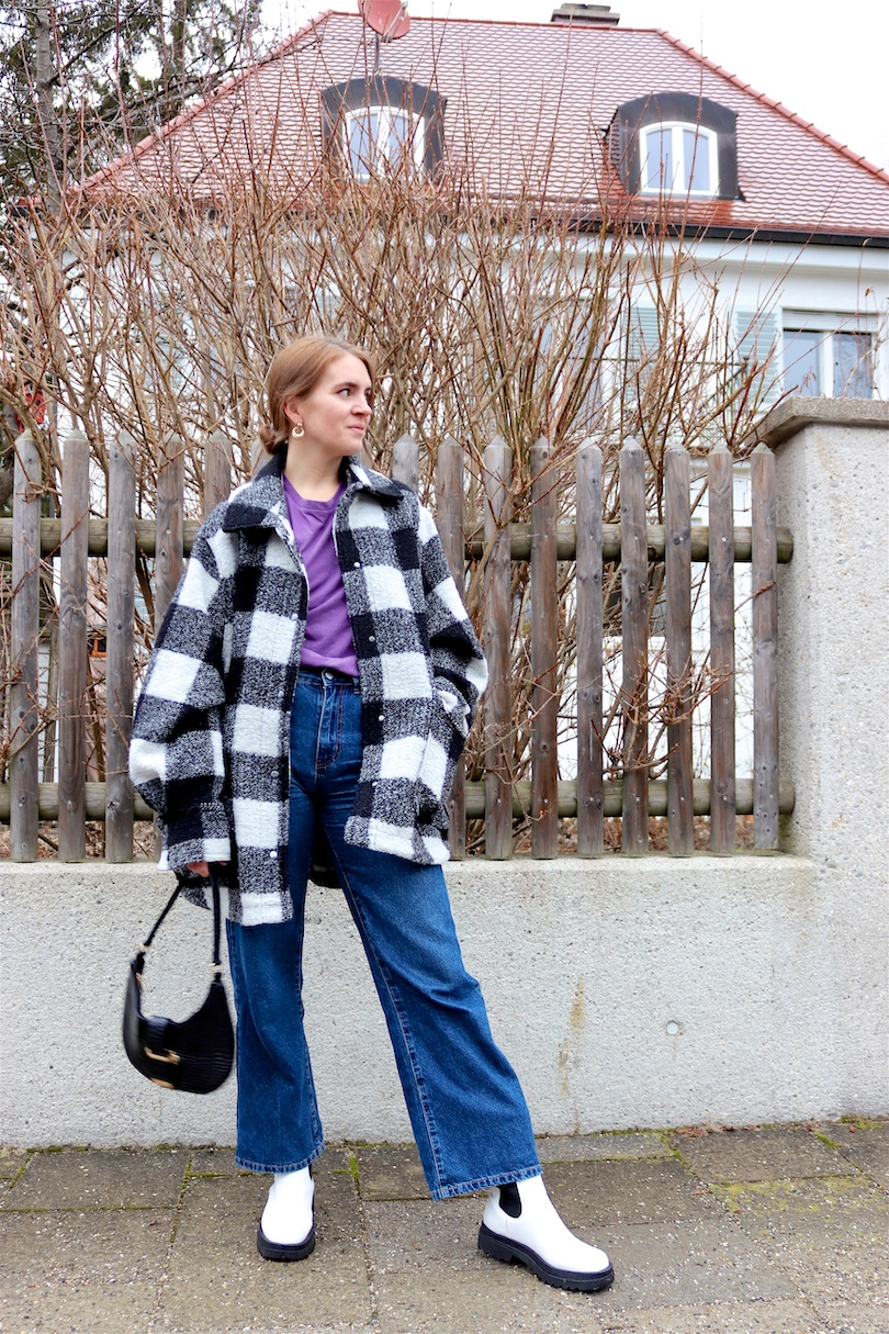 Plaid & Purple. Fashion and Style Blog Girl from Heartfelt Hunt. Girl with blonde low bun wearing a plaid jacket, purple tee, wide leg jeans, slim sunglasses, 90s bag and white boots.