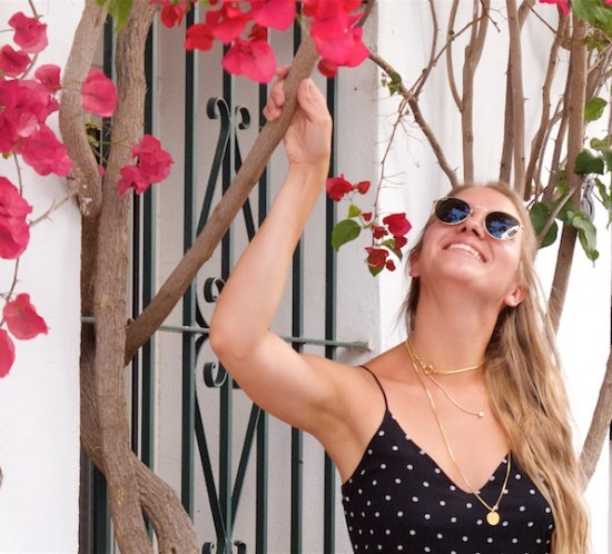 Polka Dot Pieces. Fashion Blogger Girl by Style Blog Heartfelt Hunt. Girl with blond half-up half-down hairstyle wearing a polka dot dress, Ray-Ban sunglasses, straw bag and black flats showing her favorite polka dot pieces.