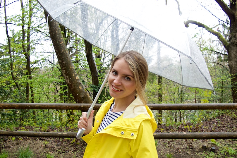 Rainy Days. Fashion and Style Blog Girl from Heartfelt Hunt. Girl wearing a yellow raincoat, striped dress and an umbrella.