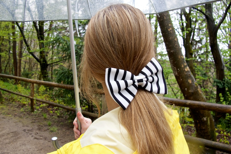 Rainy Days. Fashion Blogger Girl by Style Blog Heartfelt Hunt. Girl wearing a yellow raincoat, striped dress and a striped bow.