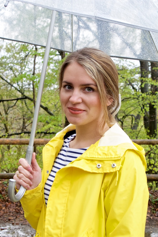 Rainy Days. Fashion Blogger Girl by Style Blog Heartfelt Hunt. Girl wearing a yellow raincoat, striped dress, striped bow and an umbrella.