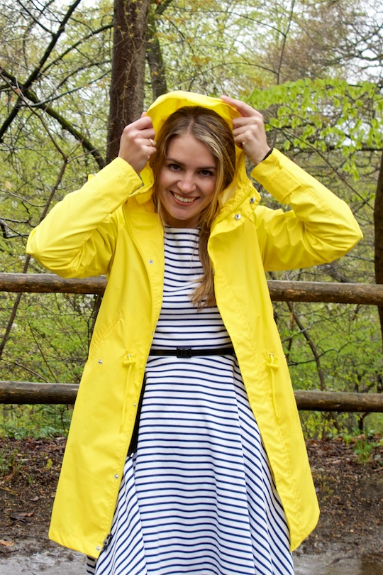 Rainy Days. Fashion and Style Blog Girl from Heartfelt Hunt. Girl wearing a yellow raincoat and a striped dress.