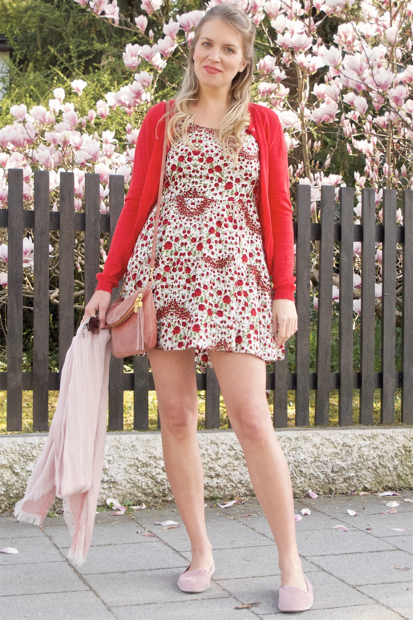 Red & Blush. Fashion and Style Blog Girl from Heartfelt Hunt. Girl with blonde half-up half-down bun wearing a red cardigan, floral dress, blush bag, scarf and velvet loafers.