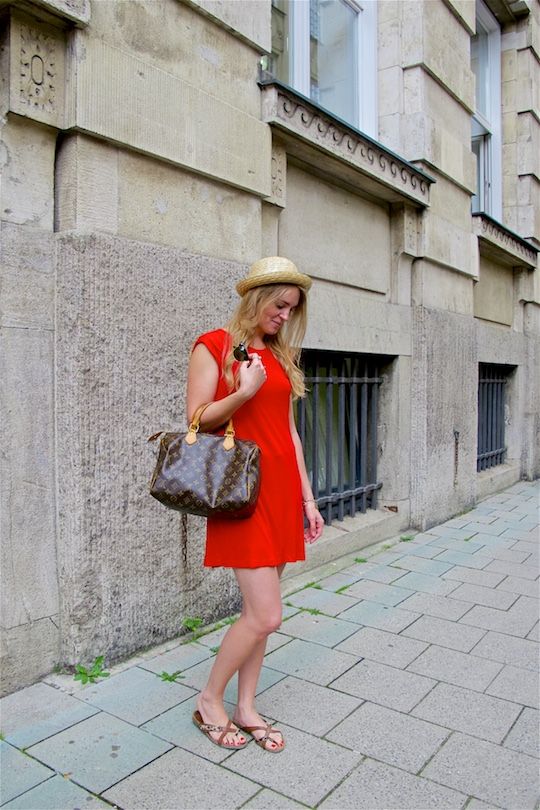 Red Dress. Fashion and Style Blog Girl from Heartfelt Hunt. Girl with blonde loose curls wearing a red dress, straw hat, Louis Vuitton bag, Ray-Ban sunglasses and sandals.