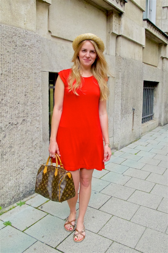 Red Dress. Fashion and Style Blog Girl from Heartfelt Hunt. Girl with blonde loose curls wearing a red dress, straw hat, Louis Vuitton bag and sandals.