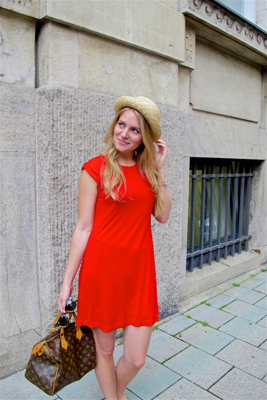 Red Dress. Fashion Blogger Girl by Style Blog Heartfelt Hunt. Girl with blond loose curls wearing a red dress, straw hat, Louis Vuitton bag, Ray-Ban sunglasses and sandals.