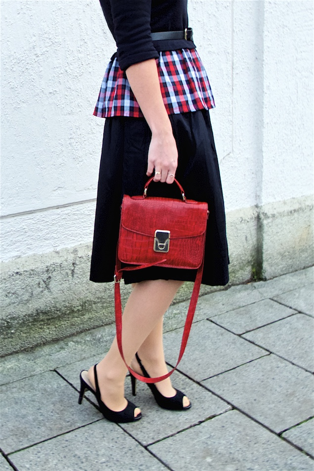 Red Plaid. Fashion Blogger Girl by Style Blog Heartfelt Hunt. Girl with blond, low bun wearing a red plaid peplum top, black midi skirt, belt, red bag and peeptoe heels.