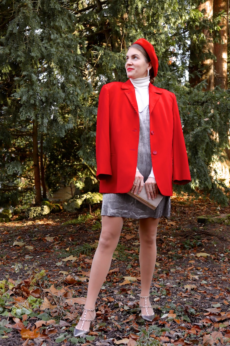 Red Silver. Fashion Blogger Girl by Style Blog Heartfelt Hunt. Girl with blond, low bun wearing a red blazer, silver slip dress, white turtleneck sweater, red beret, silver earrings, metallic clutch and metallic heels.