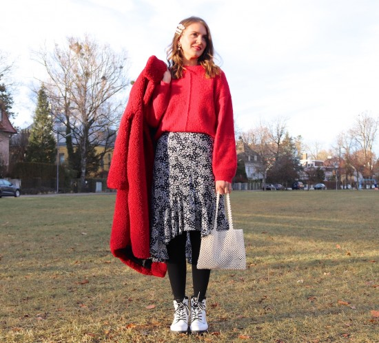 Red Teddy Coat. Fashion Blogger Girl by Style Blog Heartfelt Hunt. Girl with blond, loose curls wearing a red teddy coat, red sweater, floral midi skirt, pearl hair clips, pearl bag and white boots.