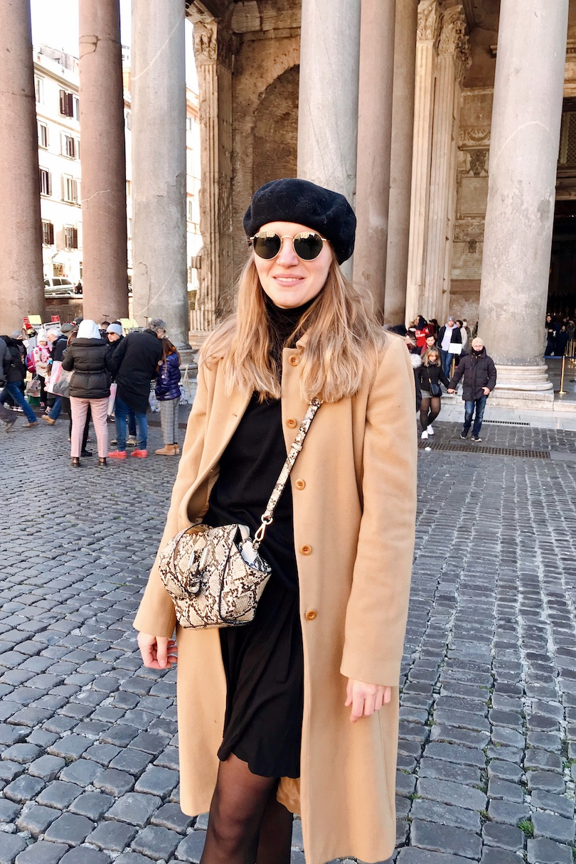 Rome. Fashion and Style Blog Girl from Heartfelt Hunt. Girl with blonde hair wearing outfit no. 1 with a red beret, red sweater, camel coat, mom jeans, Rebecca Minkof backpack, chelsea boots and outfit no. 2 with a black beret, black dress, turtleneck sweater, camel coat, snake print bag, chelsea boots.