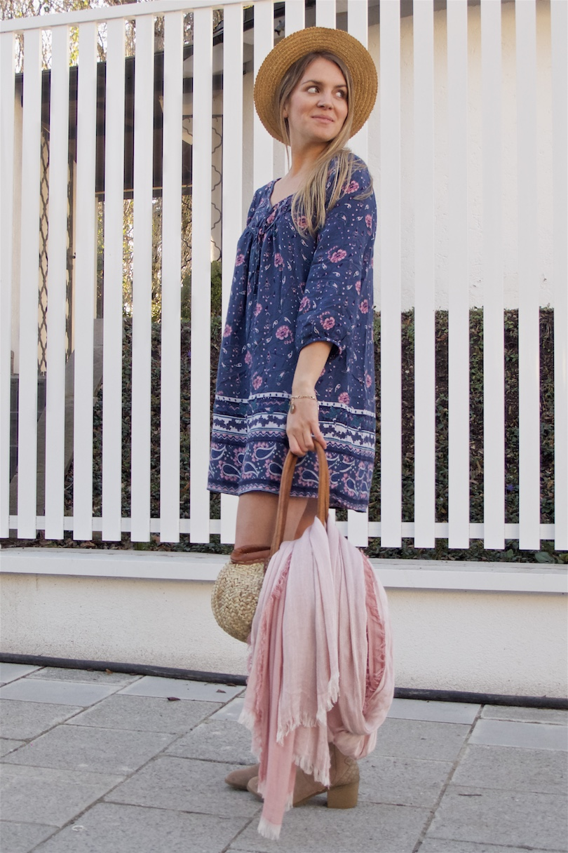 Spring Accessories. Fashion Blogger Girl by Style Blog Heartfelt Hunt. Girl with blond hair wearing a pink scarf, basket bag, straw hat, flower dress, denim jacket and boots.