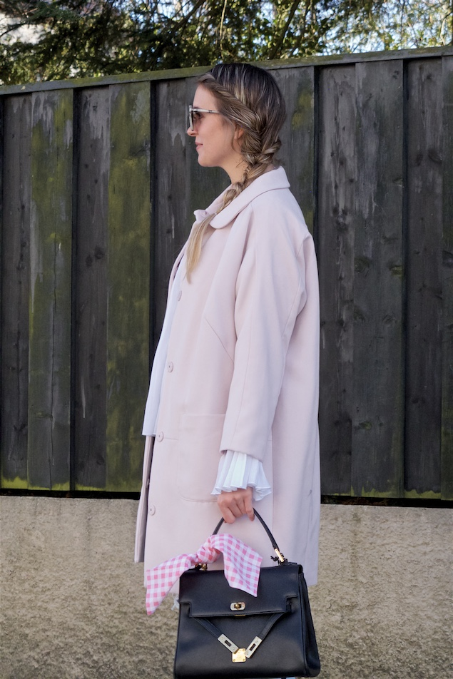Spring Pink. Fashion and Style Blog Girl from Heartfelt Hunt. Girl with blonde four strand twisted side braid wearing a spring pink coat, blouse with bell sleeves, destroyed jeans, sunglasses, bag and pink ballet flats.