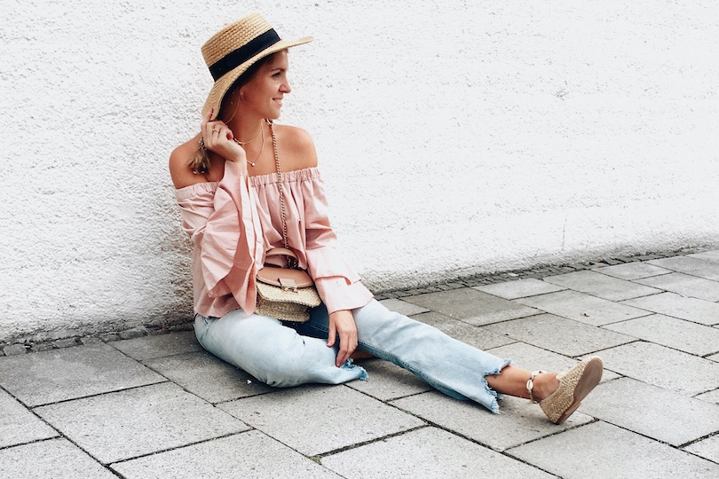 Straw Accessories. Fashion and Style Blog Girl from Heartfelt Hunt. Girl with blonde braid wearing a pink off shoulder blouse, destroyed jeans, straw hat, straw bag and straw shoes.