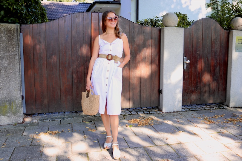 Straw Belt. Fashion and Style Blog Girl from Heartfelt Hunt. Girl with blonde, loose waves and a pearl hair clip wearing a straw belt, white button up dress, nude sunglasses, straw bag and Swedish Hasbeens.