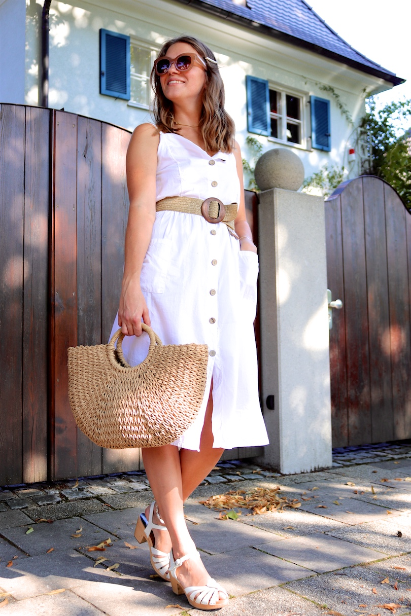 Straw Belt. Fashion Blogger Girl by Style Blog Heartfelt Hunt. Girl with blond, loose waves and a pearl hair clip wearing a straw belt, white button up dress, nude sunglasses, straw bag and Swedish Hasbeens.
