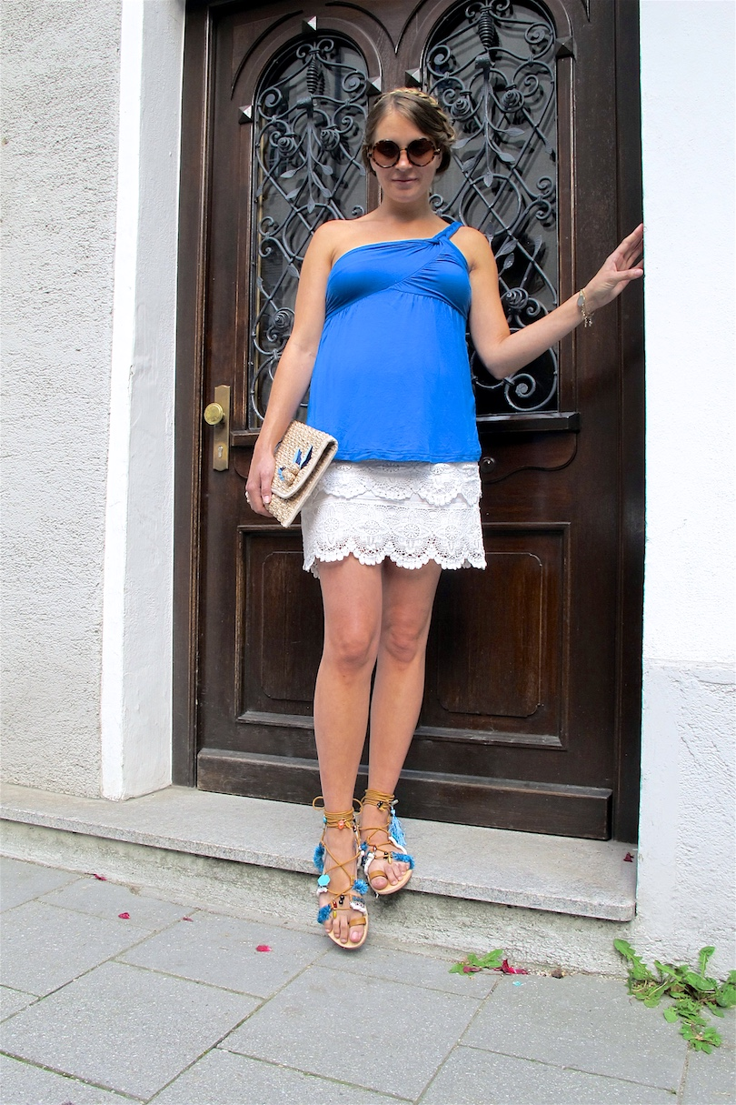 Straw Clutch. Fashion and Style Blog Girl from Heartfelt Hunt. Girl with blonde braided halo hairstyle wearing a straw clutch, blue top, lace skirt and fringe sandals.