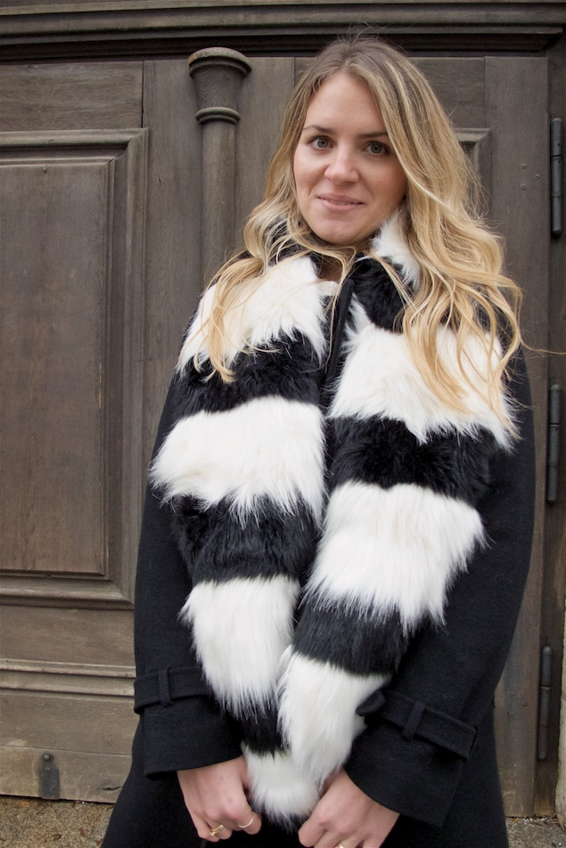 Striped Faux Fur. Fashion and Style Blog Girl from Heartfelt Hunt. Girl with blonde, loose curls wearing a striped faux fur scarf, wool coat, sweater, skirt, vintage MCM bag and chelsea boots.