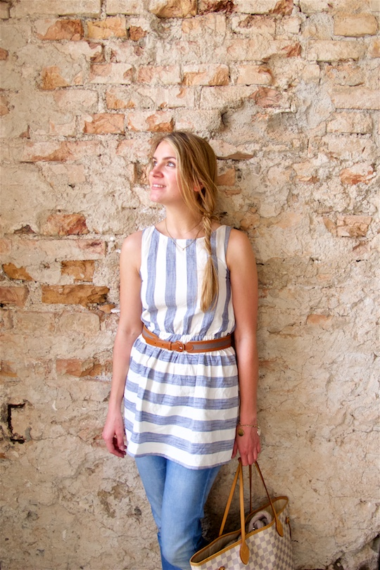 Striped Linen. Fashion Blogger Girl by Style Blog Heartfelt Hunt. Girl with messy fishtail braid wearing a cute striped linen dress, skinny jeans, belt, ballet flats and Louis Vuitton bag.