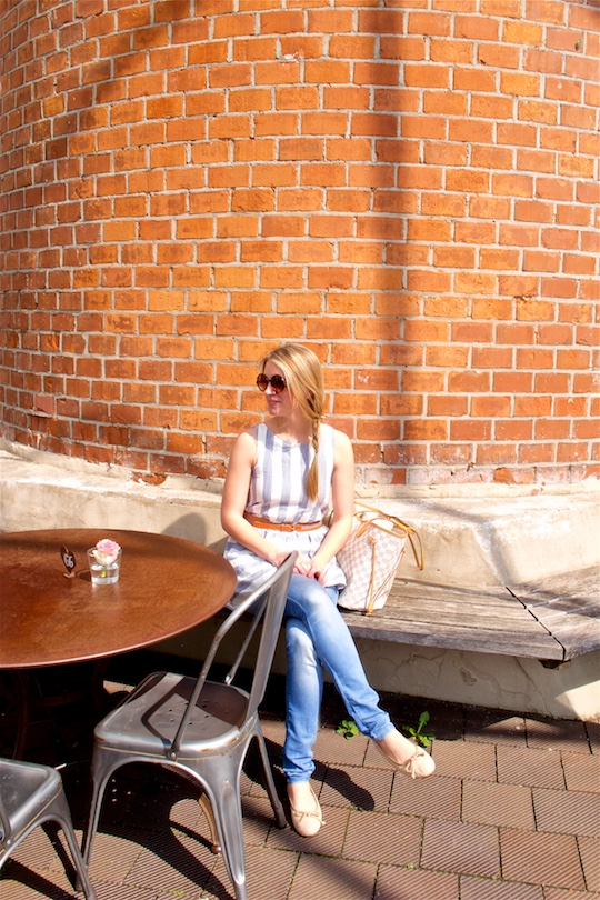 Striped Linen. Fashion and Style Blog Girl from Heartfelt Hunt. Girl with messy fishtail braid wearing a cute striped linen dress, skinny jeans, belt, ballet flats, Louis Vuitton bag and sunglasses.