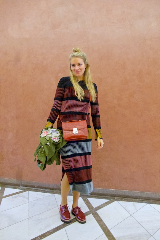 Stripes And Flowers. Fashion Blogger Girl by Style Blog Heartfelt Hunt. Girl with blond half-up half-down knot wearing a knitted dress with stripes, jacket with flowers, burgundy bag and burgundy brogues.