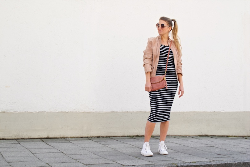 Stripes & Pink. Fashion and Style Blog Girl from Heartfelt Hunt. Girl with blonde side ponytail wearing a dress with stripes, pink suede jacket, round sunglasses, pink bag, Converse sneakers.