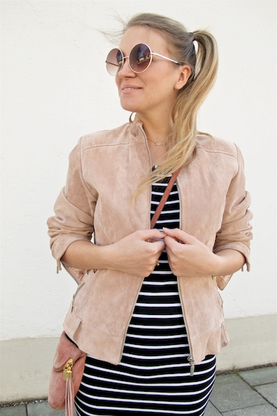 Stripes & Pink. Fashion Blogger Girl by Style Blog Heartfelt Hunt. Girl with blond side ponytail wearing a dress with stripes, pink suede jacket, round sunglasses, pink bag, Converse sneakers.